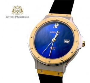 3. Reloj HUBLOT. De oro y acero. Esfera azul. Pulsera de caucho negra.Joyas - Suttons & Robertsons