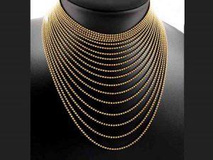 """Lote 232:Gargantilla Cartier """"Draperie"""". Formada por dieciocho hilos de cuentas esféricas de oro, dispuestas en cascada. Numerada y firmada. Precio de salida: 4.750 euros"""